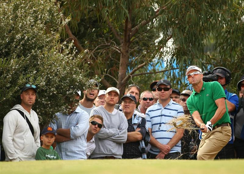 MELBOURNE, AUSTRALIA - NOVEMBER 11:  Robert Allenby of Australia hits a shot out of the rough during day one of the Australian Masters at The Victoria Golf Club on November 11, 2010 in Melbourne, Australia.  (Photo by Robert Cianflone/Getty Images)