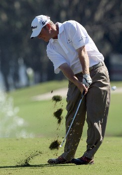 LAKE BUENA VISTA, FL - NOVEMBER 03:  Tag Ridings hits his second shot to the 1st green on the Magnolia Course during the third round of The Childrens Miracle Network Classic held on the Palm and Magnolia Courses at The Disney Shades of Green Resort, on November 3, 2007 in Lake Buena Vista, Florida.  (Photo by David Cannon/Getty Images)