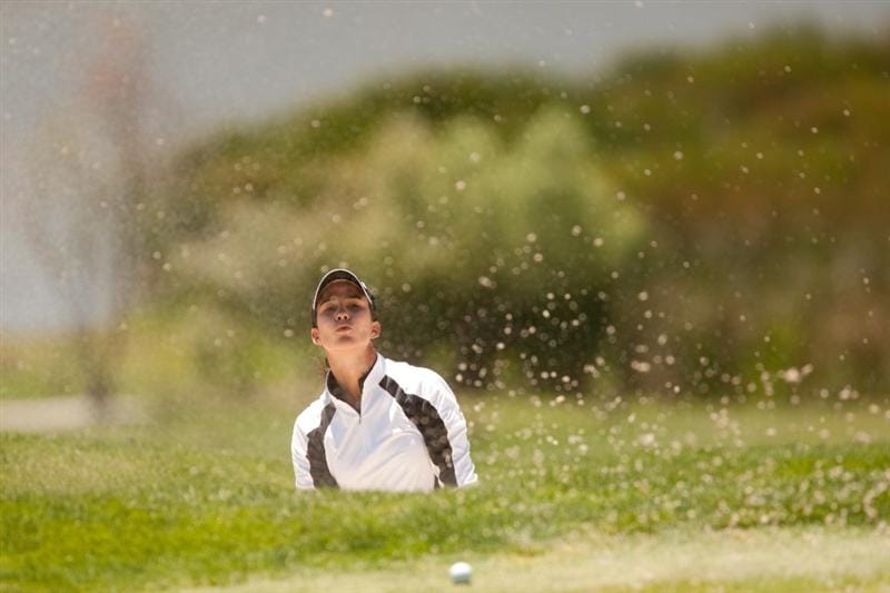 MORELIA, MEXICO - APRIL 29: Alejandra Martin del Campo of Mexico plays a bunker shot during the first round of the Tres Marias Championship at the Tres Marias Country Club on April 29, 2010 in Morelia, Mexico. (Photo by Darren Carroll/Getty Images)