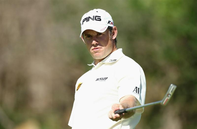 SUN CITY, SOUTH AFRICA - DECEMBER 05:  Lee Westwood of England reacts to a missed putt on the 16th green during the final round of the 2010 Nedbank Golf Challenge at the Gary Player Country Club Course  on December 5, 2010 in Sun City, South Africa.  (Photo by Warren Little/Getty Images)
