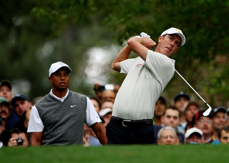 AUGUSTA, GA - APRIL 07:  Tiger Woods watches as Richard Green of Australia hits a tee shot during the first day of practice prior to the start of the 2008 Masters Tournament at Augusta National Golf Club on April 7, 2008 in Augusta, Georgia.  (Photo by Andrew Redington/Getty Images)