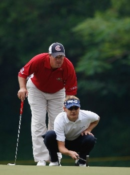 SHENZHEN, CHINA - NOVEMBER 25:  Heath Slocum and Boo Weekley of USA line up a putt on the 12th hole during the final round of the Omega Mission Hills World Cup at the Mission Hills Golf Resort on November 25, 2007 in Shenzhen, China.  (Photo by Stuart Franklin/Getty Images)