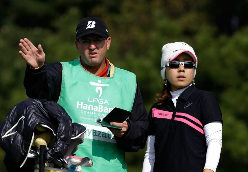 INCHEON, SOUTH KOREA - OCTOBER 31:  Mika Miyazato of Japan talks to her caddy on the 3rd hole during the 2010 LPGA Hana Bank Championship at Sky 72 Golf Club on October 31, 2010 in Incheon, South Korea.  (Photo by Chung Sung-Jun/Getty Images)
