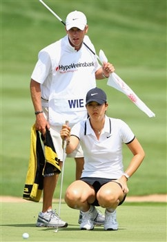 MUNICH, GERMANY - MAY 31:  Michelle Wie of USA and caddie Tim Vickers line up a putt on the fourth hole during the third round of the Hypo Vereinsbank Ladies German Open Golf at Golfpark Gut Hausern on May 31, 2008 near Munich, Germany.  (Photo by Stuart Franklin/Bongarts/Getty Images)