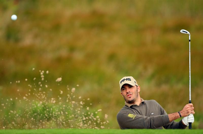 PERTH, UNITED KINGDOM - AUGUST 28:  Gregory Havret of France plays from a bunker on the first hole during the first round of The Johnnie Walker Championship at Gleneagles on August 28, 2008 at the Gleneagles Hotel and Resort in Perthshire, Scotland.  (Photo by Andrew Redington/Getty Images)