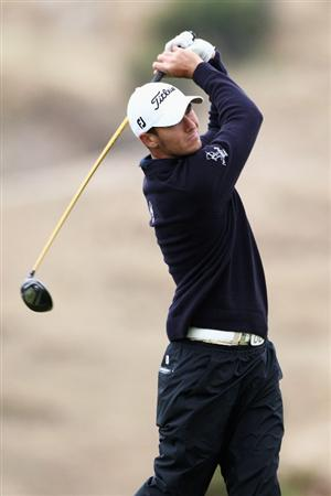 PORTO SANTO ISLAND, PORTUGAL - MAY 19:  Lloyd Saltman of Scotland tees of the 6th hole during day one of the Madeira Islands Open on May 19, 2011 in Porto Santo Island, Portugal.  (Photo by Dean Mouhtaropoulos/Getty Images)