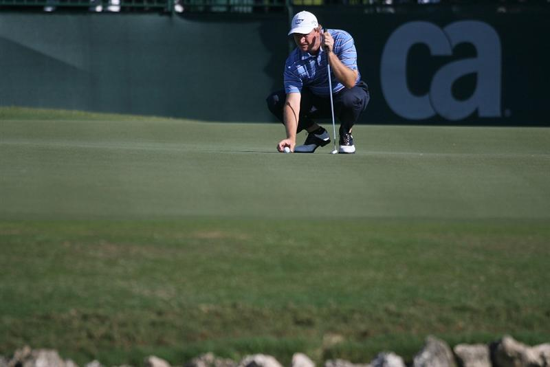 DORAL, FL - MARCH 13:  Ernie Els of South Africa lines up a putt on the ninth hole during round three of the 2010 WGC-CA Championship at the TPC Blue Monster at Doral on March 13, 2010 in Doral, Florida.  (Photo by Marc Serota/Getty Images)