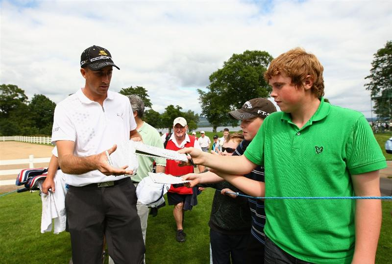 LUSS, SCOTLAND - JULY 08:  Geoff Ogilvy of Australia signs autographs during the Pro Am prior to The Barclays Scottish Open at Loch Lomond Golf Club on July 08, 2009 in Luss, Scotland.  (Photo by Richard Heathcote/Getty Images)
