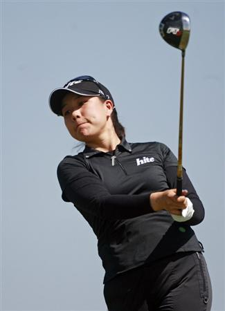 PRATTVILLE, AL - OCTOBER 1:  Joo Mi Kim of South Korea watches her drive from the ninth tee during first round play in the Navistar LPGA Classic at the Robert Trent Jones Golf Trail at Capitol Hill on October 1, 2009 in  Prattville, Alabama.  (Photo by Dave Martin/Getty Images)
