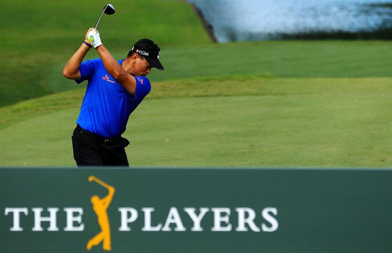 PONTE VEDRA BEACH, FL - MAY 15:  K.J. Choi of South Korea hits his tee shot on the tenth hole during the final round of THE PLAYERS Championship held at THE PLAYERS Stadium course at TPC Sawgrass on May 15, 2011 in Ponte Vedra Beach, Florida.  (Photo by Streeter Lecka/Getty Images)