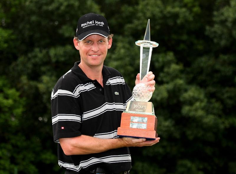 JOHANNESBURG, SOUTH AFRICA - JANUARY 11:  Anders Hansen of Denmark holds the trophy after his final round 66 to secure a one shot victory during the final round of the Joburg Open at Royal Johannesburg and Kensington Golf Club on January 11, 2009 in Johannesburg, South Africa.  (Photo by Richard Heathcote/Getty Images)