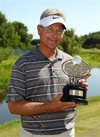 LUTZ, FL - APRIL 17:  John Cook poses with the trophy after winning the Outback Steakhouse Pro-Am at the TPC of Tampa on April 17, 2011 in Lutz, Florida.  (Photo by Mike Ehrmann/Getty Images)