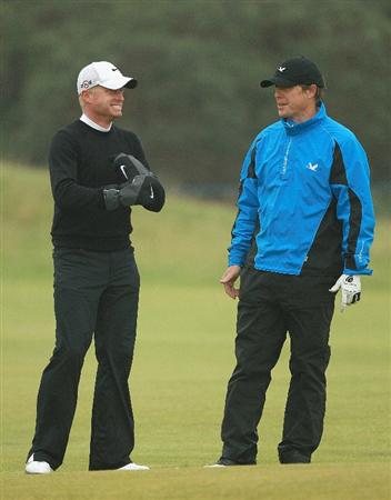 ST ANDREWS, SCOTLAND - OCTOBER 08: Simon Dyson of England talks to his playing partner Hugh Grant on the third hole during the second round of The Alfred Dunhill Links Championship at The Old Course on October 8, 2010 in St Andrews, Scotland.  (Photo by Warren Little/Getty Images)