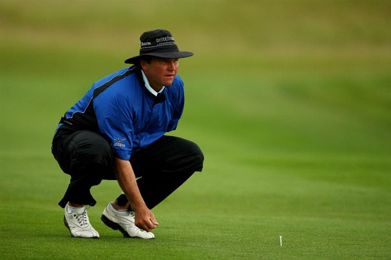 NEWPORT, WALES - JUNE 06:  Alan McLean of Scotland places his ball back on the 1st fairway during the third round of the Celtic Manor Wales Open on the 2010 Course at The Celtic Manor Resort on June 6, 2009 in Newport, Wales.  (Photo by Richard Heathcote/Getty Images)