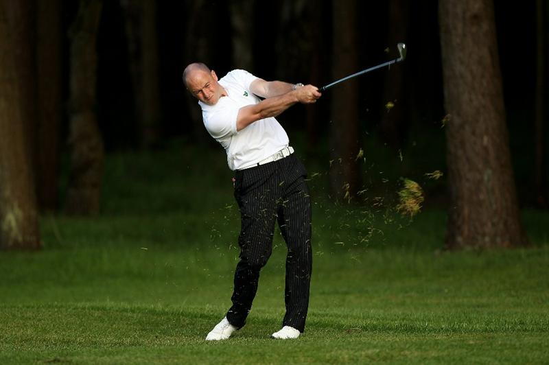 VIRGINIA WATER, ENGLAND - MAY 20:  Craig Lee of Scotland hits an approach shot during the first round of the BMW PGA Championship on the West Course at Wentworth on May 20, 2010 in Virginia Water, England.  (Photo by Andrew Redington/Getty Images)