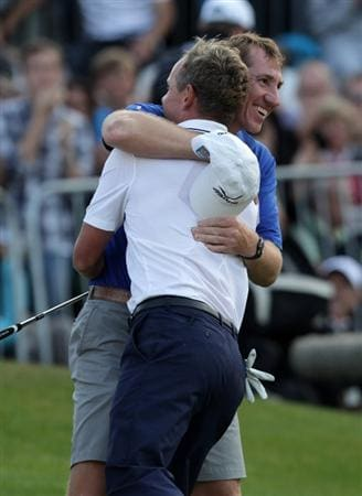 VIRGINIA WATER, ENGLAND - MAY 29:  Luke Donald of England is congratulated by his caddy John McLaren after victory in the playoff during the final round of the BMW PGA Championship  at the Wentworth Club on May 29, 2011 in Virginia Water, England.  (Photo by Ross Kinnaird/Getty Images)