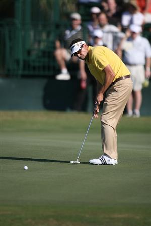 DORAL, FL - MARCH 13:  Robert Allenby of Australia putting on the ninth hole during round three of the 2010 WGC-CA Championship at the TPC Blue Monster at Doral on March 13, 2010 in Doral, Florida.  (Photo by Marc Serota/Getty Images)
