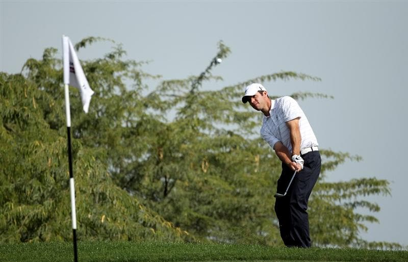 DOHA, QATAR - JANUARY 29:  Paul Casey of England plays a chip shot on the 17th hole during the second round of the Commercialbank Qatar Masters at Doha Golf Club on January 29, 2010 in Doha, Qatar.  (Photo by Andrew Redington/Getty Images)