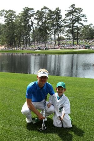 AUGUSTA, GA - APRIL 07:  Soren Kjeldsen of Denmark poses with his son/caddie Emil during the Par 3 Contest prior to the 2010 Masters Tournament at Augusta National Golf Club on April 7, 2010 in Augusta, Georgia.  (Photo by Andrew Redington/Getty Images)