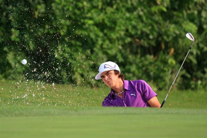 FORT WORTH, TX - MAY 20: Rickie Fowler hits his fourth shot on the 11th hole during the second round of the Crowne Plaza Invitational at Colonial Country Club on May 20, 2011 in Fort Worth, Texas. (Photo by Hunter Martin/Getty Images)