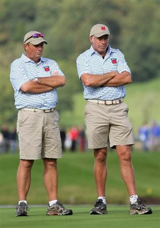 NEWPORT, WALES - OCTOBER 02:  USA Team caddies Jimmy Johnson (L) and Steve Williams wait on a green during the rescheduled Afternoon Foursome Matches during the 2010 Ryder Cup at the Celtic Manor Resort on October 2, 2010 in Newport, Wales. (Photo by Jamie Squire/Getty Images)