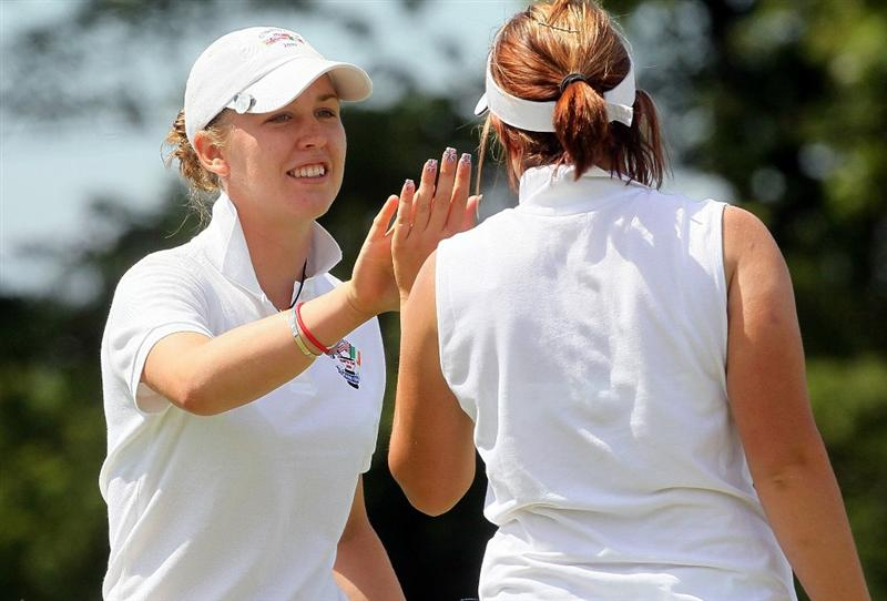 MANCHESTER, MA - JUNE 11:  Sally Watson (L) of the Great Britain and Ireland team reacts on the ninth green with teammate Rachel Jennings  in the Foursomes competition during the 2010 Curtis Cup Match at the Essex Country Club on June 11, 2010 in Manchester, Massachusetts. (Photo by Jim Rogash/Getty Images)