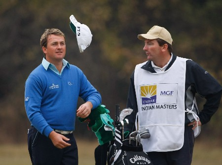 NEW DELHI, INDIA - FEBRUARY 08:  Graeme McDowell of Northern Ireland and caddie Ken Conboy during the second round of the Emaar-MGF Indian Masters at the Delhi Golf Club on February 8, 2008 in Delhi, India.  (Photo by Stuart Franklin/Getty Images)