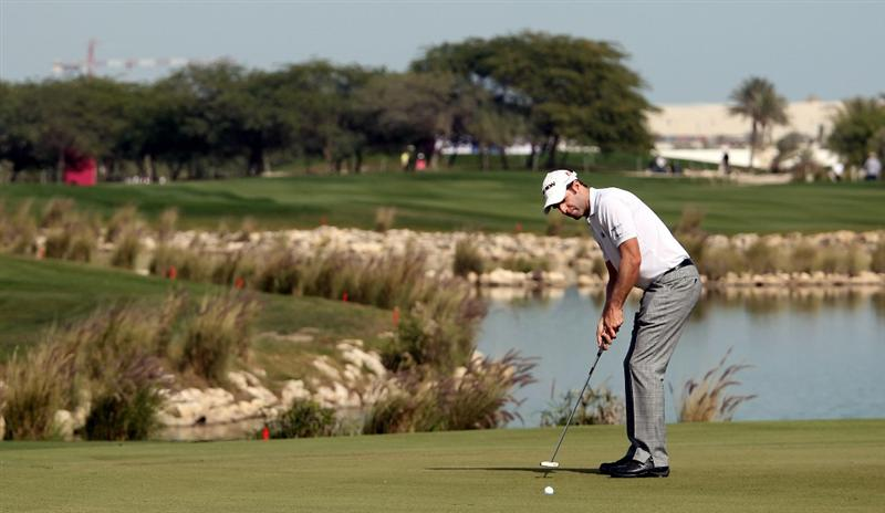 DOHA, QATAR - JANUARY 29:  Bradley Dredge of Wales on the par five 18th hole during the second round of the Commercialbank Qatar Masters at the Doha Golf Club on January 29, 2010 in Doha, Qatar.  (Photo by Ross Kinnaird/Getty Images)