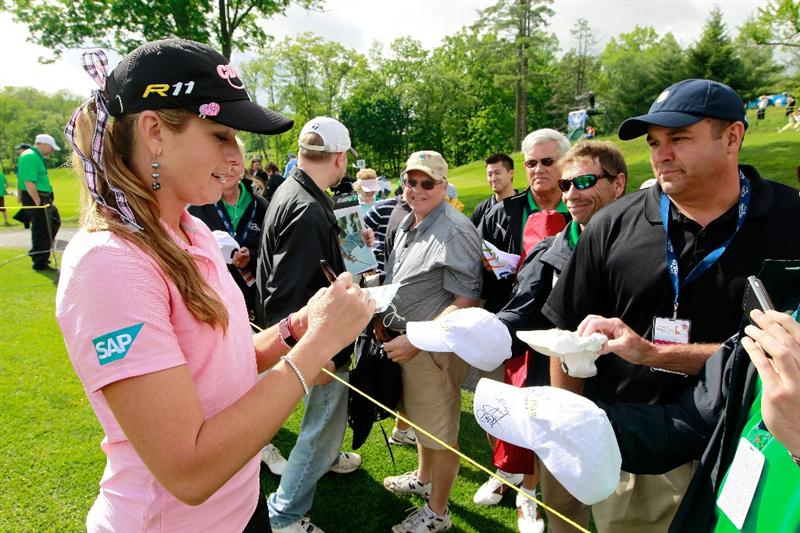 GLADSTONE, NJ - MAY 20: Paula Creamer signs autographs for fans following round two of the Sybase Match Play Championship at Hamilton Farm Golf Club on May 20, 2011 in Gladstone, New Jersey. (Photo by Chris Trotman/Getty Images)