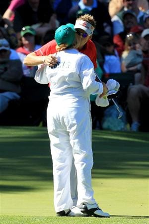 AUGUSTA, GA - APRIL 06:  Ian Poulter of England kisses his mother Theresa on the ninth green during the Par 3 Contest prior to the 2011 Masters Tournament at Augusta National Golf Club on April 6, 2011 in Augusta, Georgia.  (Photo by David Cannon/Getty Images)
