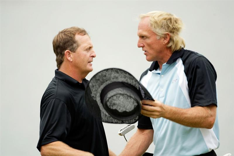 CARMEL, IN - AUGUST 01:  Fred Funk of the USA and Greg Norman of Australia shake hands on the 18th hole following the third round of the 2009 U.S. Senior Open on August 1, 2009 at Crooked Stick Golf Club in Carmel, Indiana.  (Photo by Jamie Squire/Getty Images)