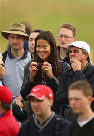 TURNBERRY, SCOTLAND - JULY 16:  Tennis player Ana Ivanovic watches the group of Adam Scott of Australia during round one of the 138th Open Championship on the Ailsa Course, Turnberry Golf Club on July 16, 2009 in Turnberry, Scotland.  (Photo by Richard Heathcote/Getty Images)