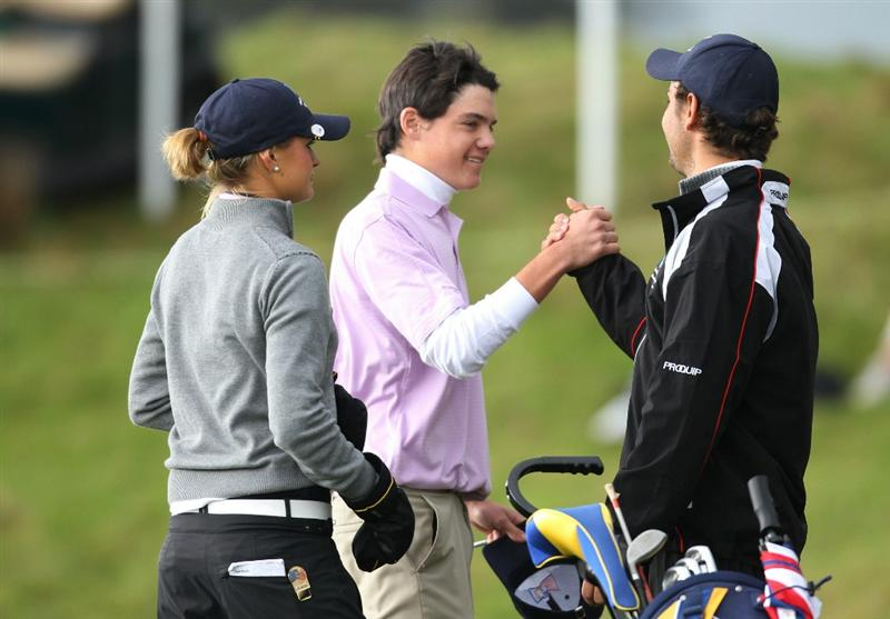 GLENEAGLES, SCOTLAND - SEPTEMBER 28:  Kristoffer Ventura (centre) celebrates with Moritz Lampert and Amy Boulden after securing a draw with Jim Liu during the second day of play at the Junior Ryder Cup at Gleneagles on September 28 2010 near Muirton, Scotland. (Photo by Ian MacNicol/Getty Images)