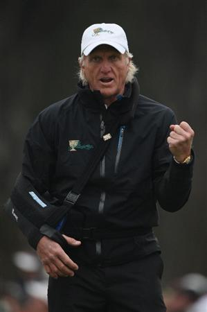 SAN FRANCISCO - OCTOBER 10:  Greg Norman, Captain of the International Team celebrates a putt from Tim Clark during the Day Three Afternoon Fourball Matches of The Presidents Cup at Harding Park Golf Course on October 10, 2009 in San Francisco, California.  (Photo by Warren Little/Getty Images)
