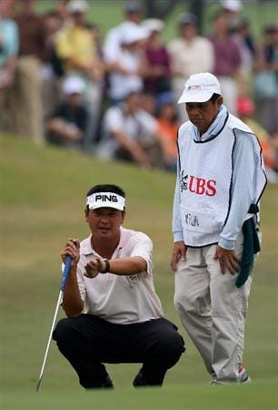 HONG KONG, CHINA - NOVEMBER 23:  Lin Wen - Tang of Taiwan and caddy line up a putt on the third hole during the final round of the UBS Hong Kong Open at the Hong Kong Golf Club on November 23, 2008 in Fanling, Hong Kong.  (Photo by Stuart Franklin/Getty Images)