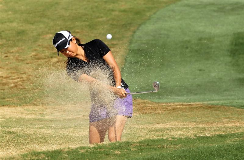 PHOENIX, AZ - MARCH 19:  Mina Harigae hits out of a bunker on the on the sixth hole during the second round of the RR Donnelley LPGA Founders Cup at Wildfire Golf Club on March 19, 2011 in Phoenix, Arizona.  (Photo by Stephen Dunn/Getty Images)