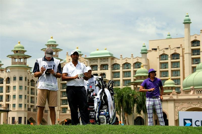 KUALA LUMPUR, MALAYSIA - OCTOBER 29: Arjun Atwal of India and Ricky Fowler of USA looks on on the 13th hole during day two of the CIMB Asia Pacific Classic at The MINES Resort & Golf Club on October 29, 2010 in Kuala Lumpur, Malaysia.  (Photo by Stanley Chou/Getty Images)
