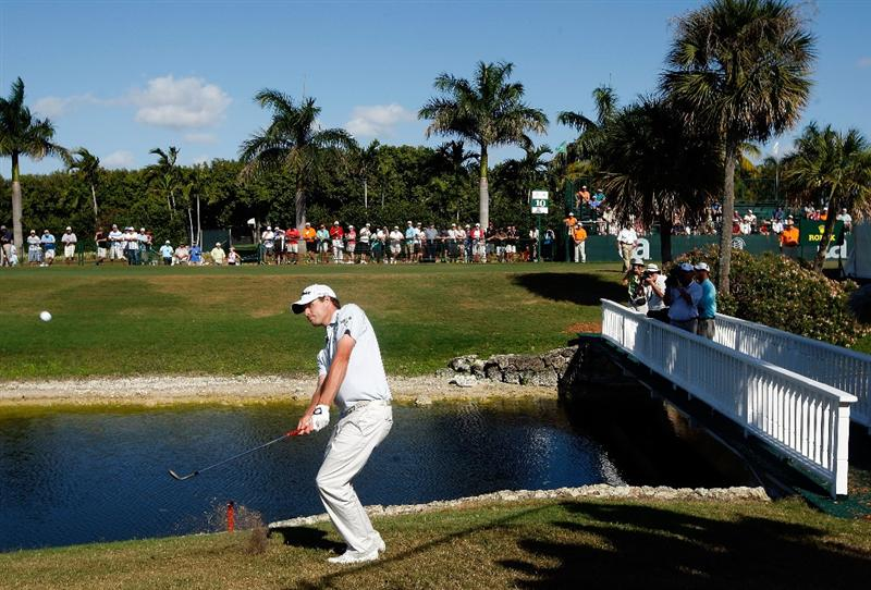 DORAL, FL - MARCH 15:  Nick Watney chips in on the 9th hole during the final round of the World Golf Championships-CA Championship on March 15, 2009 at the Doral Golf Resort and Spa in Doral, Florida.  (Photo by Jamie Squire/Getty Images)