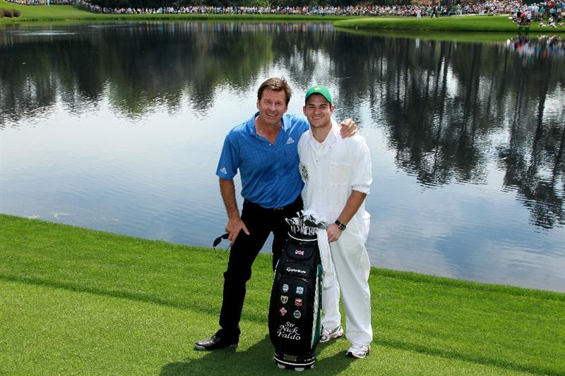 AUGUSTA, GA - APRIL 07:  Nick Faldo of England poses with his caddie during the Par 3 Contest prior to the 2010 Masters Tournament at Augusta National Golf Club on April 7, 2010 in Augusta, Georgia.  (Photo by David Cannon/Getty Images)