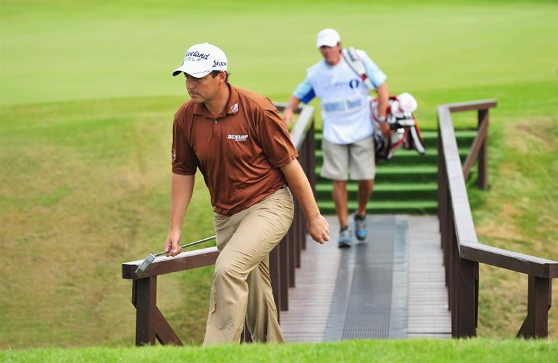 TURNBERRY, SCOTLAND - JULY 16:  David Howell of England crosses the bridge on the 16th hole during round one of the 138th Open Championship on the Ailsa Course, Turnberry Golf Club on July 16, 2009 in Turnberry, Scotland.  (Photo by Stuart Franklin/Getty Images)