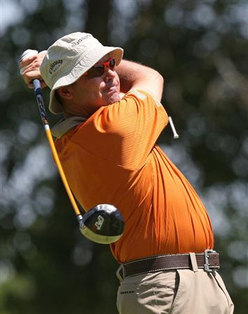 MILWAUKEE - JULY 16: Rich Beem tees off on the 10th hole during the first round of the U.S. Bank Championship on July 16, 2009 at the Brown Deer Park golf course in Milwaukee, Wisconsin. (Photo by Jonathan Daniel/Getty Images)