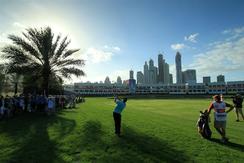 DUBAI, UNITED ARAB EMIRATES - FEBRUARY 13:  Anders Hansen of Denmark plays his third shot at the 18th hole during the final round of the 2011 Omega Dubai Desert Classic on the Majilis Course at the Emirates Golf Club on February 13, 2011 in Dubai, United Arab Emirates.  (Photo by David Cannon/Getty Images)