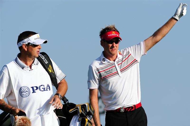 CHASKA, MN - AUGUST 14:  Ian Poulter of England waits with his caddie Terry Mundy on the 11th tee during the second round of the 91st PGA Championship at Hazeltine National Golf Club on August 14, 2009 in Chaska, Minnesota.  (Photo by Stuart Franklin/Getty Images)