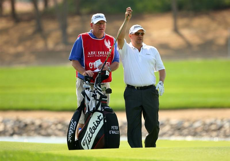 ABU DHABI, UNITED ARAB EMIRATES - JANUARY 16:  Peter O'Malley of Australia waits with his caddie on the 17th hole during the second round of The Abu Dhabi Golf Championship at Abu Dhabi Golf Club on January 16, 2009 in Abu Dhabi, United Arab Emirates.  (Photo by Andrew Redington/Getty Images)