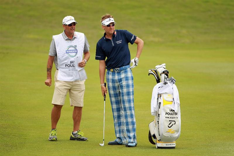 CASARES, SPAIN - MAY 19:  Ian Poulter of England stands with his caddie Terry Mundy during the group stages of the Volvo World Match Play Championship at Finca Cortesin on May 19, 2011 in Casares, Spain.  (Photo by Andrew Redington/Getty Images)