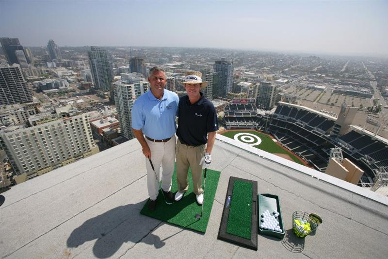 SAN DIEGO - MAY 18: PGA TOUR Player Briny Baird and Padres GM Kevin Towers pose for a photo before hitting off the roof of the Omni Hotel attempting to land a golf ball on a bulls-eye planted in right-center field at PETCO Park during the P.F. Chang's Chip for Charity on May 18, 2009 in San Diego, California.  (Donald Miralle/Getty Images )