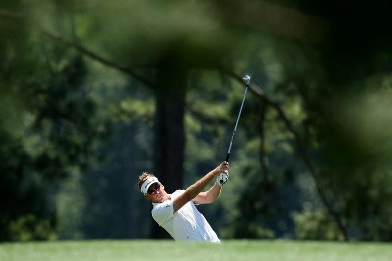 AUGUSTA, GA - APRIL 12:  Ian Poulter of England hits a shot on the first hole during the final round of the 2009 Masters Tournament at Augusta National Golf Club on April 12, 2009 in Augusta, Georgia.  (Photo by David Cannon/Getty Images)