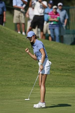PRATTVILLE, AL - OCTOBER 1:  Michelle Wie reacts after making a birdie on the 18th hole during first round play in the Navistar LPGA Classic at the Robert Trent Jones Golf Trail at Capitol Hill on October 1, 2009 in  Prattville, Alabama.  (Photo by Dave Martin/Getty Images)