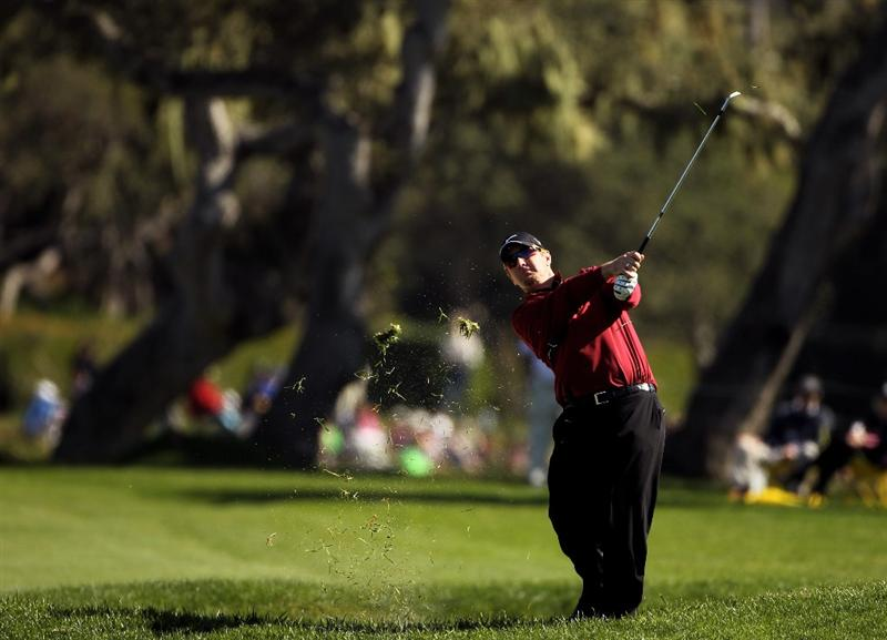 PEBBLE BEACH, CA - FEBRUARY 14:  David Duval hits his approach shot on the 15th hole during the final round of the AT&T Pebble Beach National Pro-Am at Pebble Beach Golf Links on February 14, 2010 in Pebble Beach, California.  (Photo by Ezra Shaw/Getty Images)