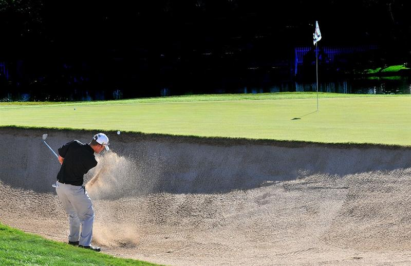 SCOTTSDALE AZ - OCTOBER 25: Chris Riley hits out of the greenside bunker on the 18th hole during the third round of  the Fry's.Com Open held at Grayhawk Golf Club on October 25, 2008 in Scottsdale, Arizona. (Photo by Marc Feldman/Getty Images)